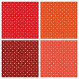 Seamless vector patterns or textures set with white polka dots on pastel, colorful red, orange, brown and peach pink background
