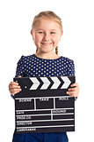 smiling girl with clapper board