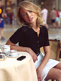 beautiful woman sitting in a Cafe with mobile s