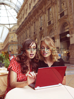 happy businesswomen with laptop