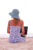 girl with laptop on the beach