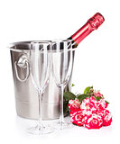 Champagne bottle, two glasses and red rose flowers