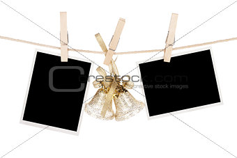Blank photo frames and christmas decor hanging on the clotheslin