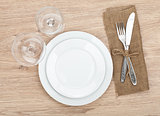 Empty plate, wine glasses and silverware set