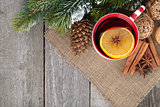 Christmas mulled wine with fir tree and decor