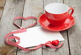 Blank valentines greeting card and red coffee cup
