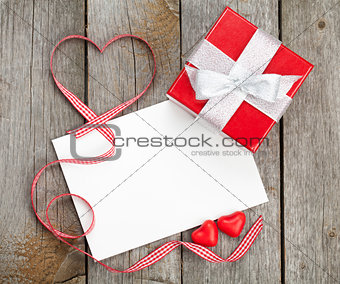 Blank valentines greeting card and small red gift box