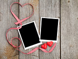 Two photo frames and small red candy heart