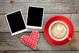 Two photo frames over wooden background with red coffee cup