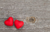 Two candy hearts on wooden background
