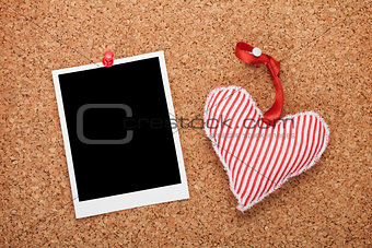 Blank instant photo and red heart