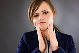 Closeup portrait of a young businesswoman having toothache
