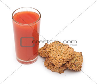 tomato juice glass with cookies isolated on white background