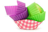 stack of vibrant cupcake wrappersisolated on white.