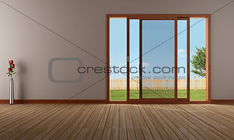 Empty living room with open sliding window
