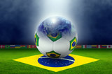 Soccer stadium, ball, globe, flag of Brazil