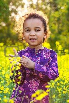 African American Girl Child in Field of Yellow Flowers