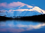 Winter mountains and lake snowy landscape