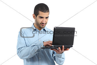 Arab casual man browsing a laptop social media