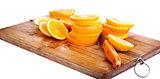 cut oranges on kitchen board