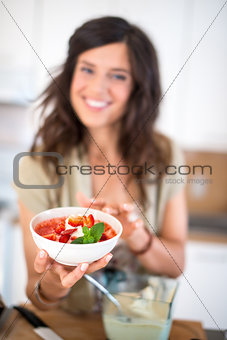 Multi ethnic girl preparing raw food
