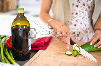 Multi ethnic girl preparing raw food
