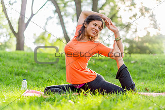 Beautiful woman doing yoga at sunset