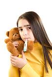 Cute sick girl measures the temperature