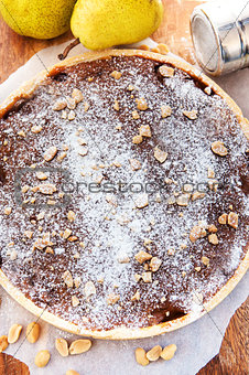 Caramel apple tart with nuts and sugar powder