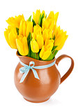 yellow tulips flowers in jug