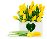 spring yellow tulips in wooden basket