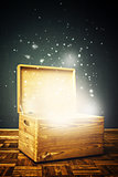 Open magical Wooden crate box on the floor