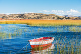 boat in Titicaca Lake peruvian Andes at Puno Peru