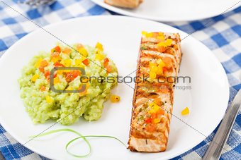 Creamy avocado rice with grilled salmon
