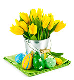 easter eggs with yellow tulips in bucket