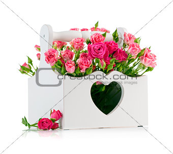 bouquet pink roses in wooden basket
