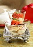 Italian dessert tiramisu decorated with strawberries