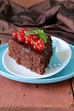 super chocolate cake (brownie) decorated with red currant and mint