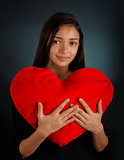 Girl Holding a Big Plush Heart