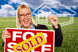 Woman with Sold For Sale Sign, Keys and Ghosted House