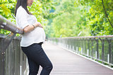 Pregnant Asian woman at outdoor