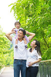 Happy Asian family outdoor fun.