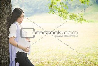 Portrait of pregnant Asian woman