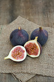 Fresh figs on hessian napkins on wooden background