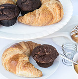 Continental breakfast table setting with pastries and cakes