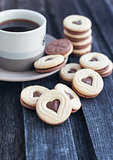 Cup of coffee and heart shaped cut out cookies