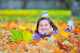 little girl on autumn