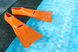 Orange Rubber flippers in pool