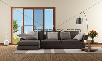 Modern living room with brown sofa