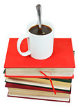 mug of coffee on stack of books